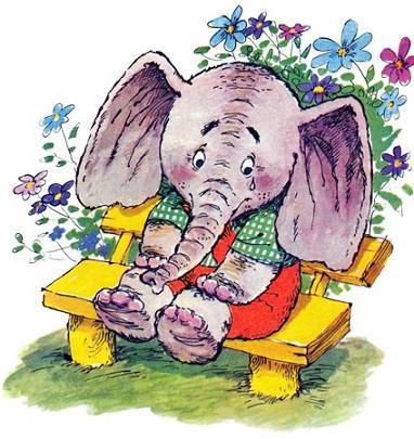 слонёнок сидит на лавочке и плачет
